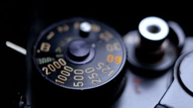 close-up details of an old vintage slr film camera and exposure speed dial - slr camera stock videos and b-roll footage