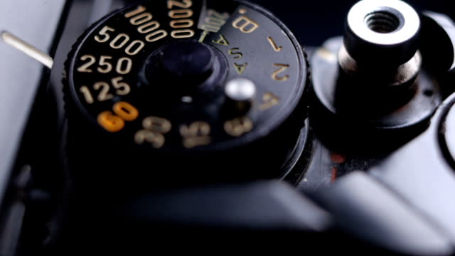 close-up details of an old vintage slr film camera and shutter release button - selective focus stock videos & royalty-free footage