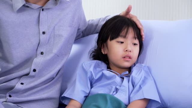 close-up: doctor explaining illness of asian girl while father is belong to her in hospital ward - modern manhood stock videos & royalty-free footage