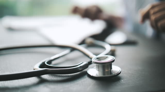 close-up doctor working - stethoscope stock videos & royalty-free footage