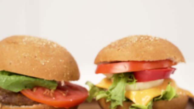 close-up dolly shot: cheeseburger and burger - fast food stock videos & royalty-free footage