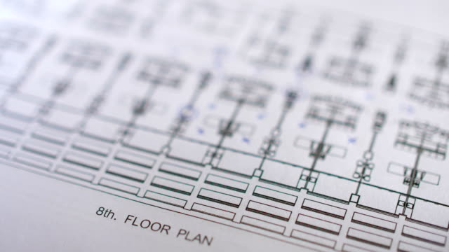 close-up dolly shot of engineer checking drawing plan of building - pair of compasses stock videos & royalty-free footage