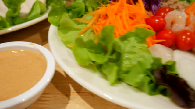 close-up dolly shot:serving delicious seafood salad - salmon salad stock videos & royalty-free footage