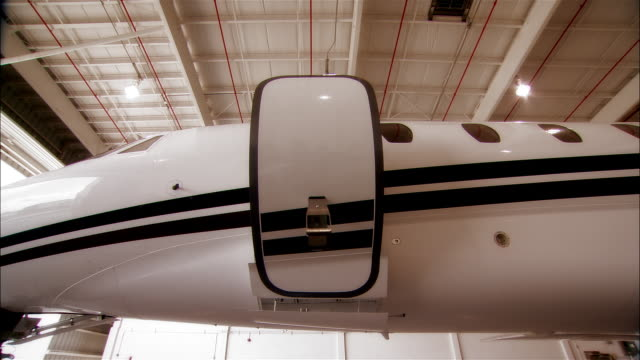 close-up door of private jet closing in hangar at opa locka airport/ miami, florida, usa - vehicle door stock videos & royalty-free footage