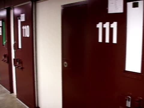 Closeup Doors to prison cells lining corridor of Guantanamo Bay detention center/ Guantanamo Province Cuba