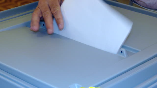 close-up - elected ballot in the ballot box for voting - voting ballot stock videos and b-roll footage