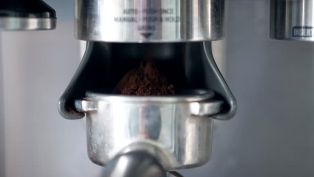 close-up espresso machine with coffee grounds - coffee drink stock videos & royalty-free footage