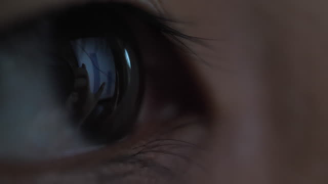 close-up eye looking computer surfing internet at night - sensory perception stock videos & royalty-free footage