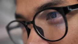 Close-up eye looking Laptop