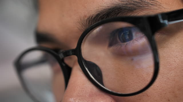 close-up eye looking laptop - eyeglasses stock videos & royalty-free footage
