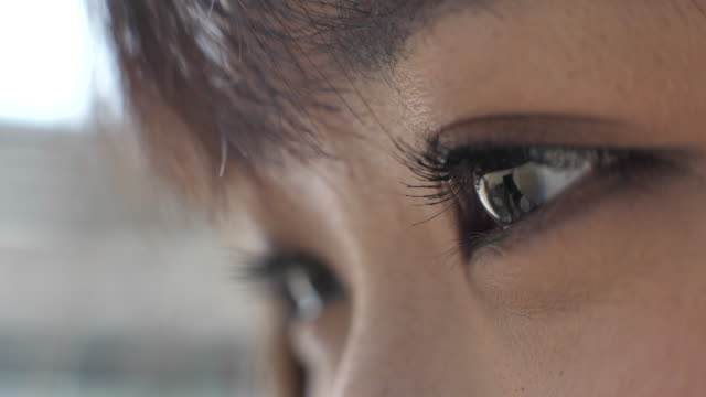 close-up eye looking smart phone - east asian ethnicity stock videos & royalty-free footage