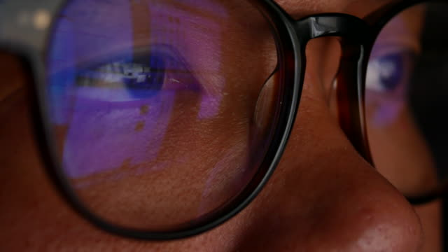 close-up eye of businessman looking on computer screen with glasses - programmer stock videos & royalty-free footage