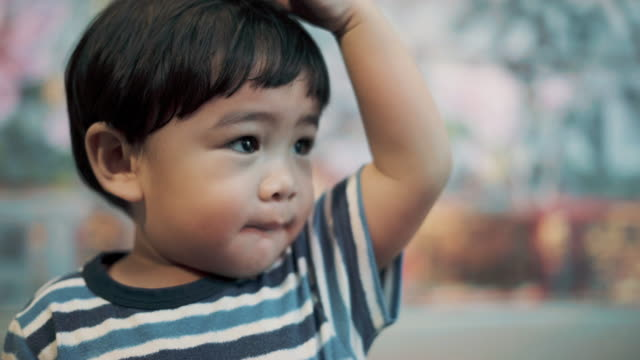 close-up face baby boy - one baby boy only stock videos & royalty-free footage