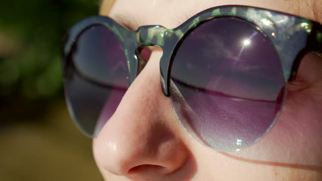 close-up face of beautiful girl in sunglasses. tidal bore reflection - eyeglasses stock videos & royalty-free footage
