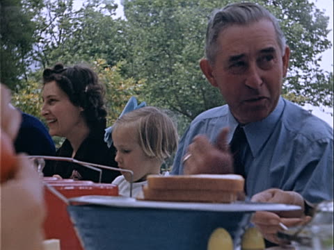 1939 close-up family eating picnic lunch together in griffith park / los angeles, california, usa  - home movie stock videos & royalty-free footage
