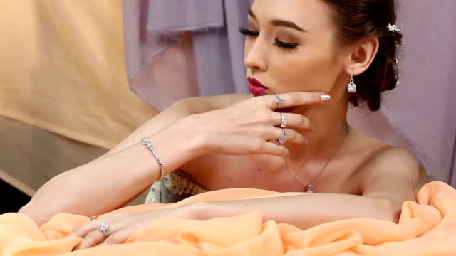 close-up fashion portrait of diamond ring, necklace, bracelet, earrings sensual caucasian lady - necklace stock videos & royalty-free footage