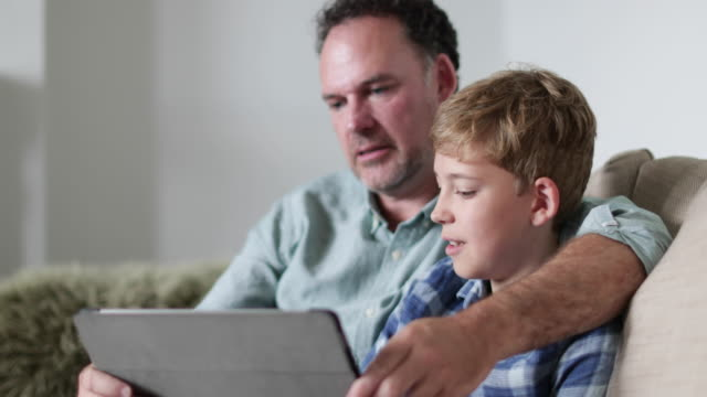 Close-up Father and Son looking at a digital tablet