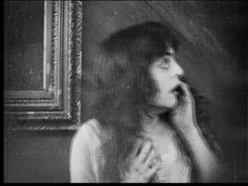 1916 b/w close-up fearful woman screaming with hands on face - fear stock videos & royalty-free footage