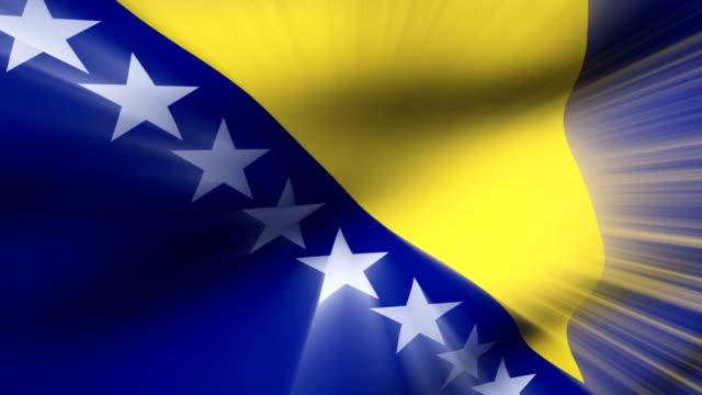 vidéos et rushes de close-up flag of bosnia ripples in a breeze. - banderole signalisation