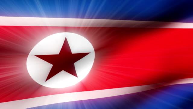 vidéos et rushes de close-up flag of north korea ripples in a breeze. - banderole signalisation