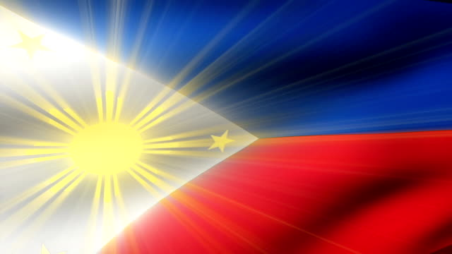 close-up flag of philippines ripples in a breeze. - philippines flag stock videos & royalty-free footage