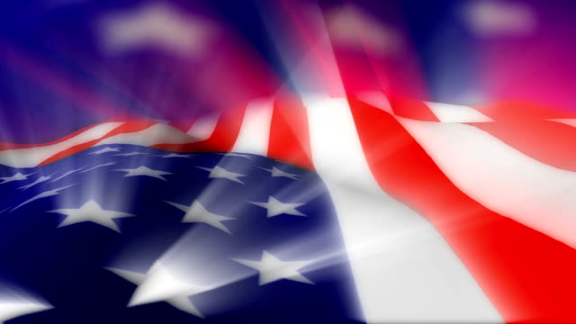 Close-up flag of United States ripples in a breeze.