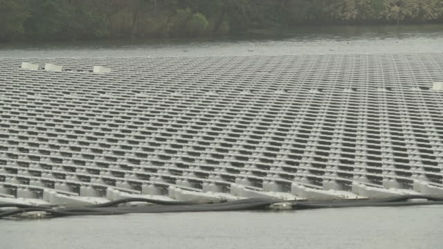 close-up; floating solar panels, chiba, japan - hydroelectric power stock videos & royalty-free footage