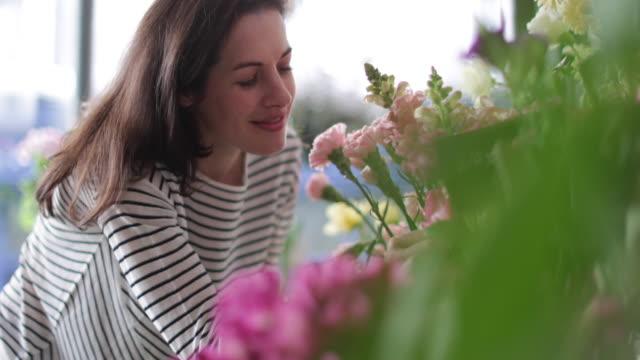 Closeup florist working in store
