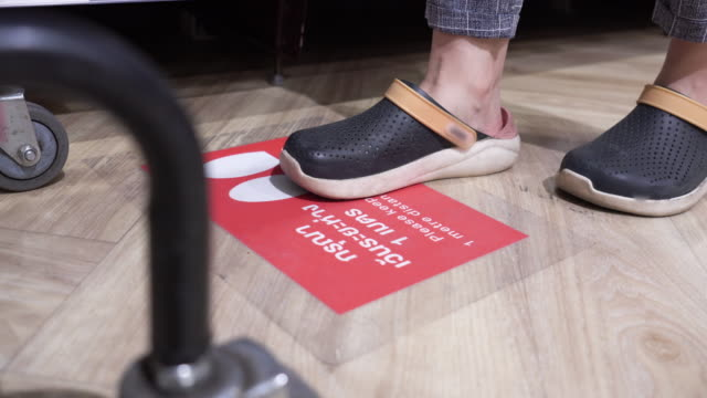 close-up foot of customers waiting in line - shoes in a row stock videos & royalty-free footage