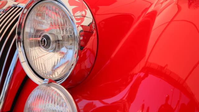 closeup front light car. - collector's car stock videos and b-roll footage