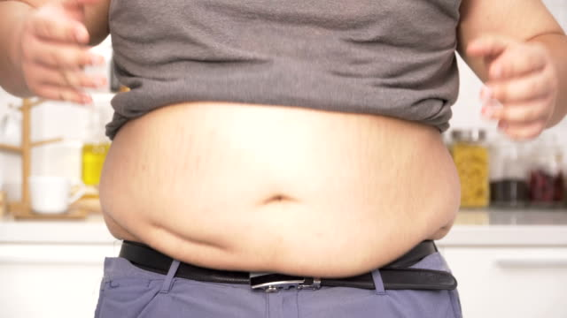 close-up front view:stomach of  thai overweight man feel anxiety on a big belly - navel stock videos & royalty-free footage