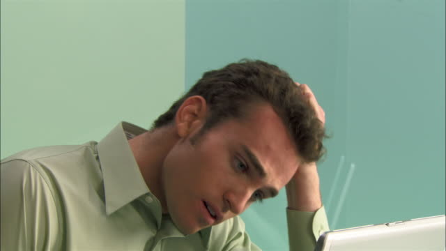 Close-up Frustrated young businessman pulling his hair