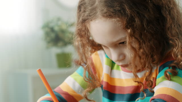 close-up, girl doing homework. - elementary student stock videos & royalty-free footage