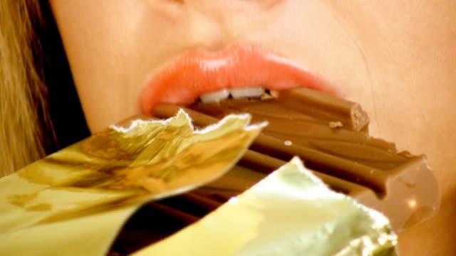 Closeup girl eating chocolate