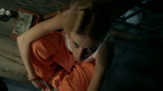 Close-up, girl in prison cell