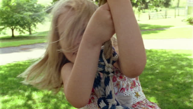 close-up girl swinging on tire swing / des moines, king county, washington, usa - tyre swing stock videos & royalty-free footage