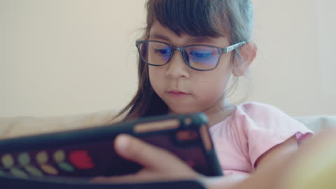 [close-up] girl using tablet - eyeglasses stock videos & royalty-free footage