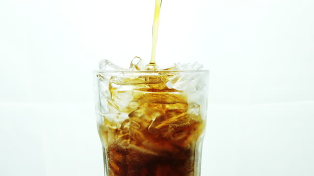 close-up glass of cola with ice cubes. - carbonated stock videos & royalty-free footage