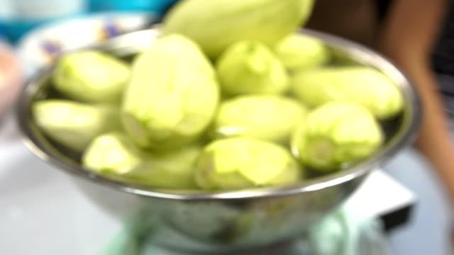 close-up: green mango in salt solution - mango stock videos & royalty-free footage