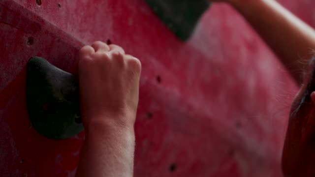 close-up gripping climbing wall - concentration stock videos & royalty-free footage