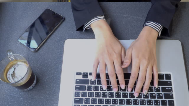 4k close-up hand businesswoman using laptops for work. - computer keyboard stock videos and b-roll footage