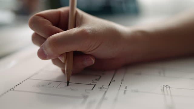 close-up hand engineer checking and drawing on blue print - architecture stock videos & royalty-free footage