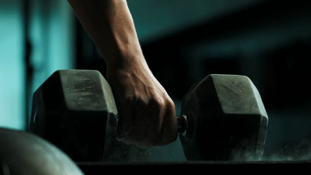close-up hand holding dumbbell - dumbbell stock videos & royalty-free footage