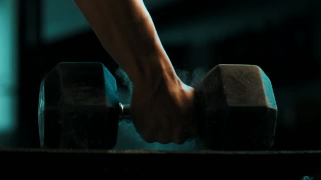close-up hand holding dumbbell - flooring stock videos & royalty-free footage