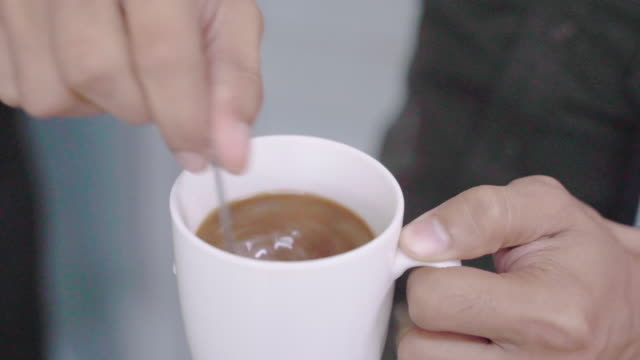 closeup hand man of the coffee and refreshing drink after work hours, the caffeine in coffee lovers a fresh stimulus. - caffeine stock videos & royalty-free footage