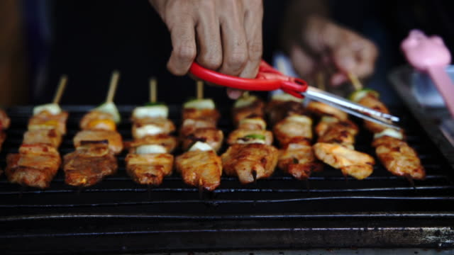 closeup hand man or pinging grill chef, barbeques on the stove. - skewer stock videos & royalty-free footage