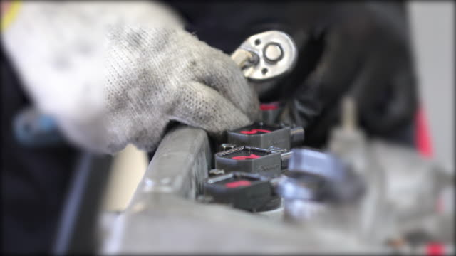 close-up hand of auto mechanic repair engine and check the car for faults and errors - car engine stock videos & royalty-free footage