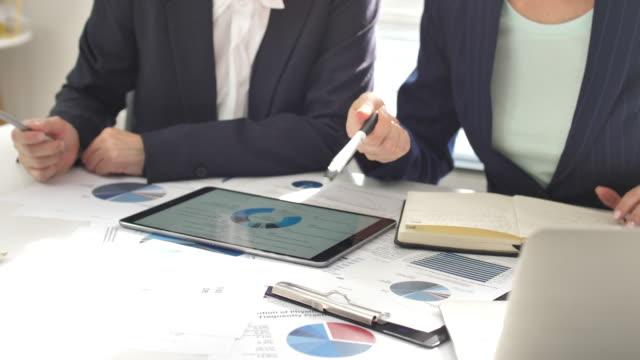 close-up hand of business-meeting mit digital tablet und business document - konzepte und themen stock-videos und b-roll-filmmaterial