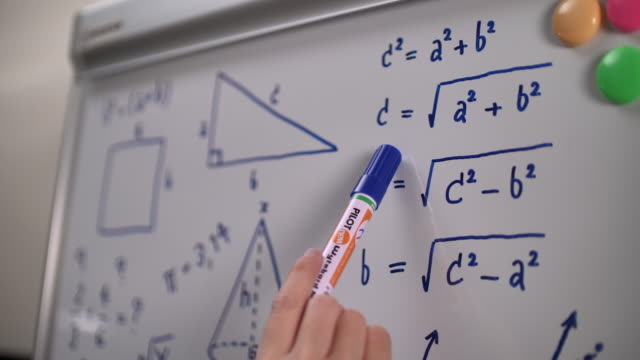 close-up hand of student solving math problem - educational exam stock videos & royalty-free footage
