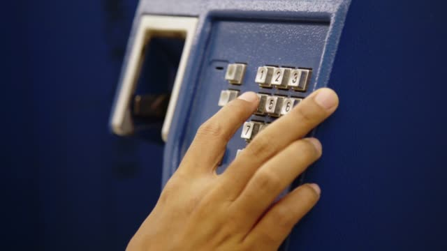 closeup hand of woman using public telephone or phone booth station. - hanging stock videos & royalty-free footage